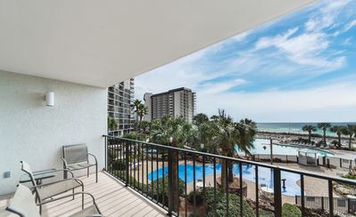 Photo for New Listing! Upscale resort condo w/ pool & beach views! Poolside dining, WiFi!