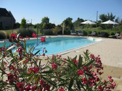 Relax in and around the large heated pool