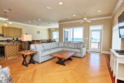2nd Floor Main Level Living Space with a Large Sectional and Balcony Access