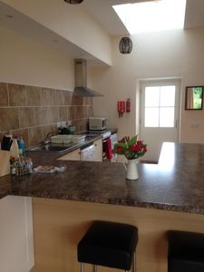 Open plan Kitchen with dishwasher, fridge with freezer, microwave, washer etc