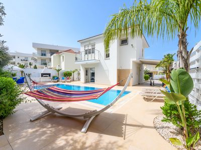 Photo for Modern villa next to the beach - High spec throughout ***FREE UNLIMITED WI-FI***