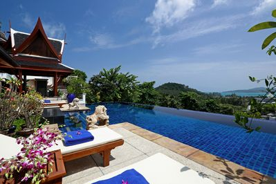 Pool terrace with view over infinity pool to Bang Tao bay