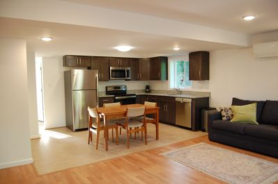 Fully equipped kitchen with new high end appliances and linoleum flooring.