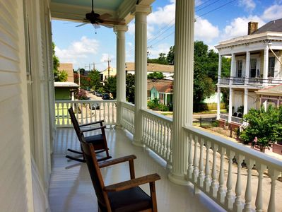 Rocking chairs & ceiling fans on the 2nd floor balcony overlooking the Marigny