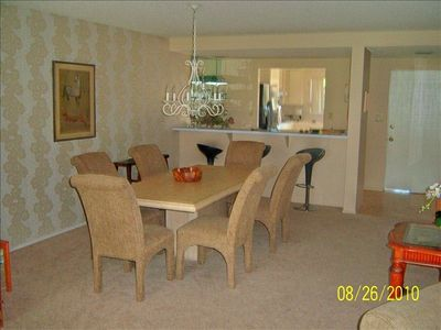 Dining area and breakfast bar open to the kitchen-