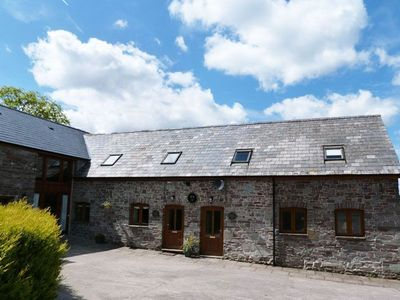 Photo for After relaxing in the hot tub, sleep under the eaves of this tastefully converted barn on a working