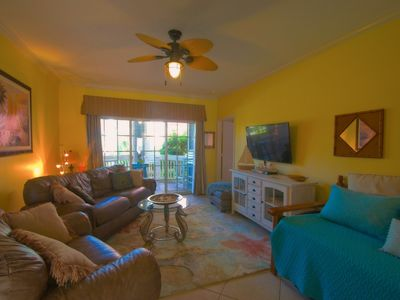 Photo for Handicapped accessible; 2 Pools! Hot SPA! Beach front; Close to all attractions!