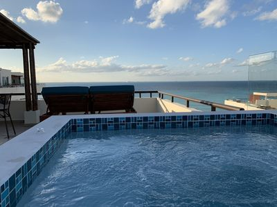 Watch the sunset from the private hot tub