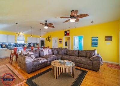 Living area with comfy sectional and amazing window views of Rollover Bay.