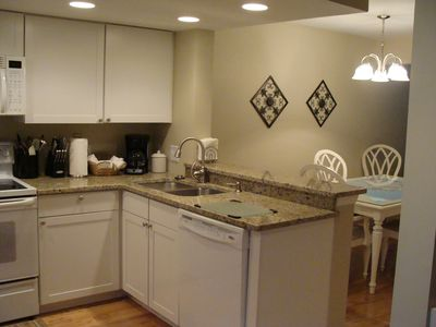 RECENTLY REMODELED KITCHEN WITH NEW CABINETS AND GRANITE COUNTERTOPS