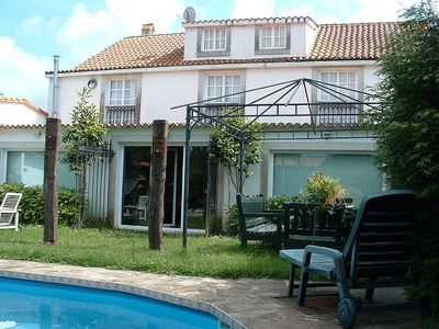 Photo for Lovely holiday house with pool and barbacue near the beach