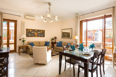 Large and sunny living room with 2 sets of French doors to terrace.