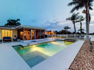 Photo for NEW LISTING! Riverfront house w/private pool, dock, & lanai - dogs welcome!