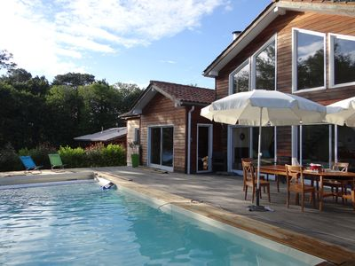 Photo for Contemporary wooden house with pool
