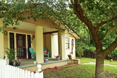 The cozy porch and yard of the Blue Crab Bungalow