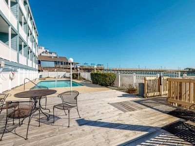Photo for Oceanfront condo w/ beautiful views & shared pool - right next to pier!