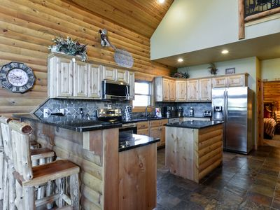 Photo for Luxury Lakefront Chalet~2 Pools~FREE Amenities~Dock~Kayaks~Waterslide