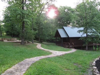 Rental Cabin and fire pit with a grill and smoker