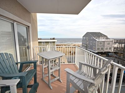 Photo for Nice, spacious 3 bedroom condo with free WiFi, an outdoor pool, and partial ocean views located midtown on the ocean block just a couple minutes from the beach!