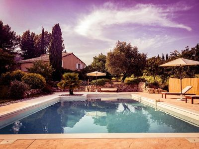 Photo for Provencal farmhouse surrounded by vineyards, superb view, nature, calm, large swimming pool