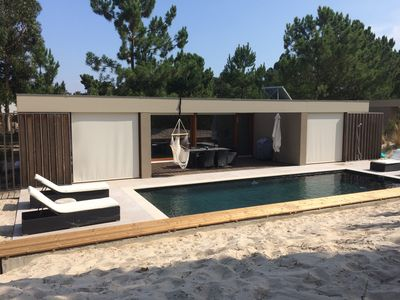 Photo for Four bedroom villa with pool situated on a nature reserve with private beach
