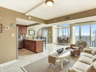 DAILY ACTIVITIES & LINENS INCLUDED*! Oceanfront bi-level penthouse.  Nicely furnished with overstuffed sofas with wicker chair & ottoman in living room.