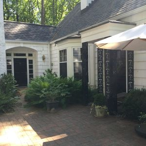 Private patio entrance with seating, dining, grill and firepit