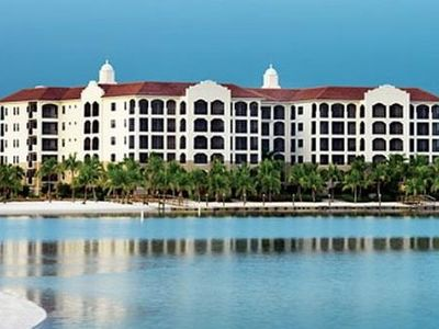 Mirasol Building overlooking lake with views toward the Clubhouse & Private Pool