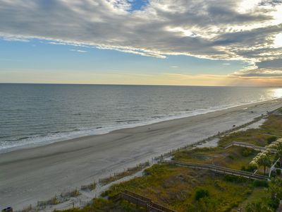 Photo for 4 bedroom, 3 bath oceanfront condo. WIFI, washer/dryer.  Sleeps 8.  Indoor, outdoor pool, 2 lazy rivers, kiddie pools, hot tub areas, fitness center with ocean view.