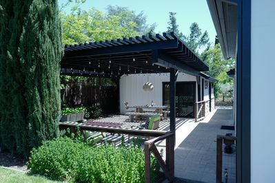 Large private outdoor dining covered trellis patio