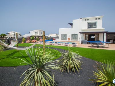 Photo for Stunning Villa with beautiful landscaped gardens, AC and private pool