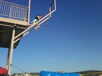 Jumping off the top deck. Safe & fun! It's 15 ft. deep. We suggest life jackets!