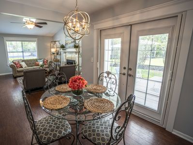 The dining area has French doors leading to the patio area overlooking the pond