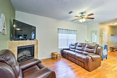 In the living area, there is a flat-screen cable TV right above the fireplace.
