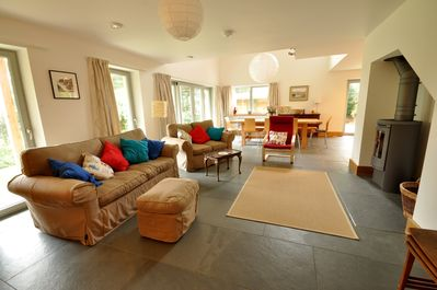 Open plan sitting room looking towards dining area