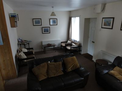 The front door opens onto the open plan sitting area