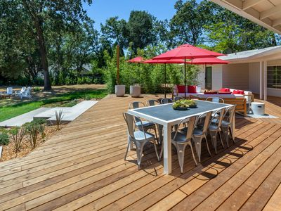 Deck  - Host cookouts on the spacious deck, configured with alfresco dining for 10.