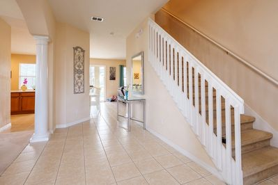 Spacious hallway leading through to the family room.