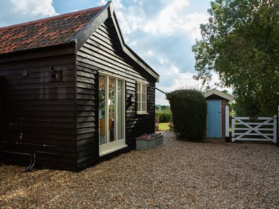 Photo for One bedroom barn with open plan living area, private patio/garden,great sunsets