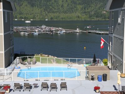 Photo for Lakefront beach condo swimming pool hot tub marina - Sicamous Mara Lake Shuswaps
