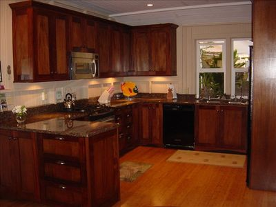 Kitchen with granite counter tops and dishwasher