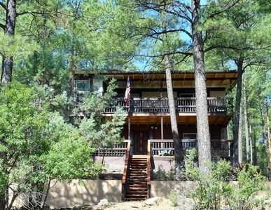Photo for Rustic Cabin in the Tall Pines Close to Town  w/ Deck & Gas Grill