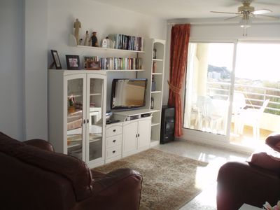 Light, airy living room, UK and Spanish tv, DVD player, radio, comfy sofas!