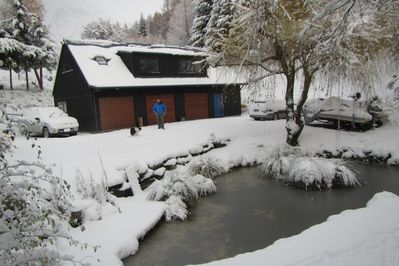 pond and barn in winter