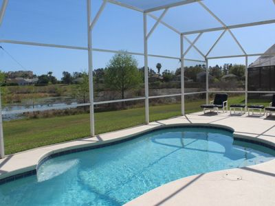 Photo for 4 bed 3 bath south facing pool home with water views and themed bedrooms at Rolling Hills, Formosa Gardens, Kissimmee