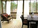Enjoying a cup of coffee or an evening dinner, this porch is a favorite spot.