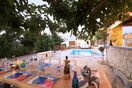 Outdoor dining area and communal swimming pool