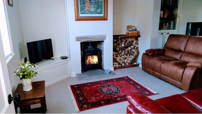 Living room with wood burner and two comfy recliner sofas