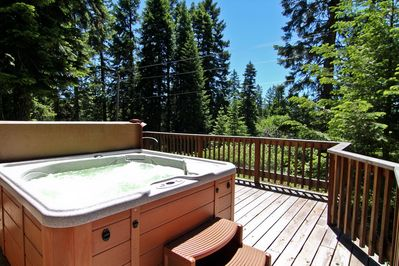 Private hot tub for a relaxing getaway.