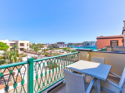 Photo for Modern condo in waterfront building with shared pool, close to the beach & golf